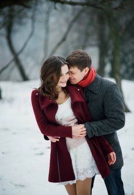 Attractive young couple in love in the snowy Park