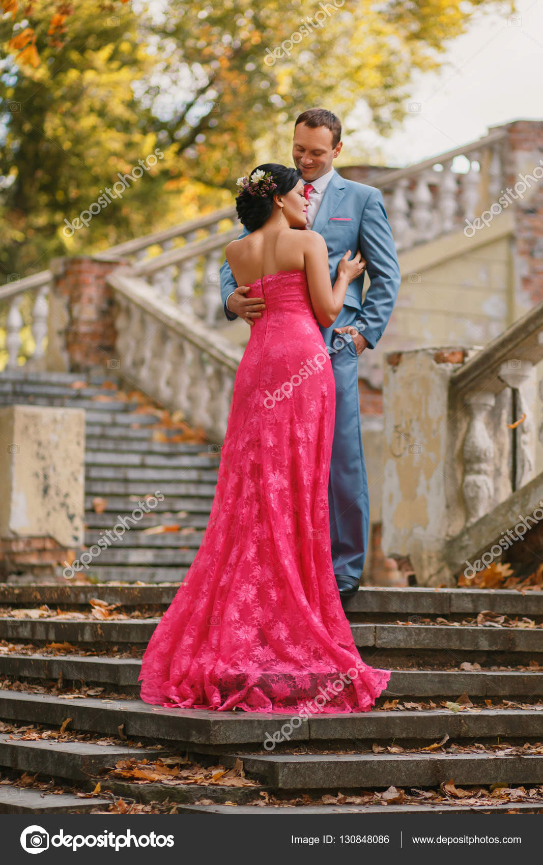 Romantic Couple On Stairs He Gently Looks At Her Stock Photo