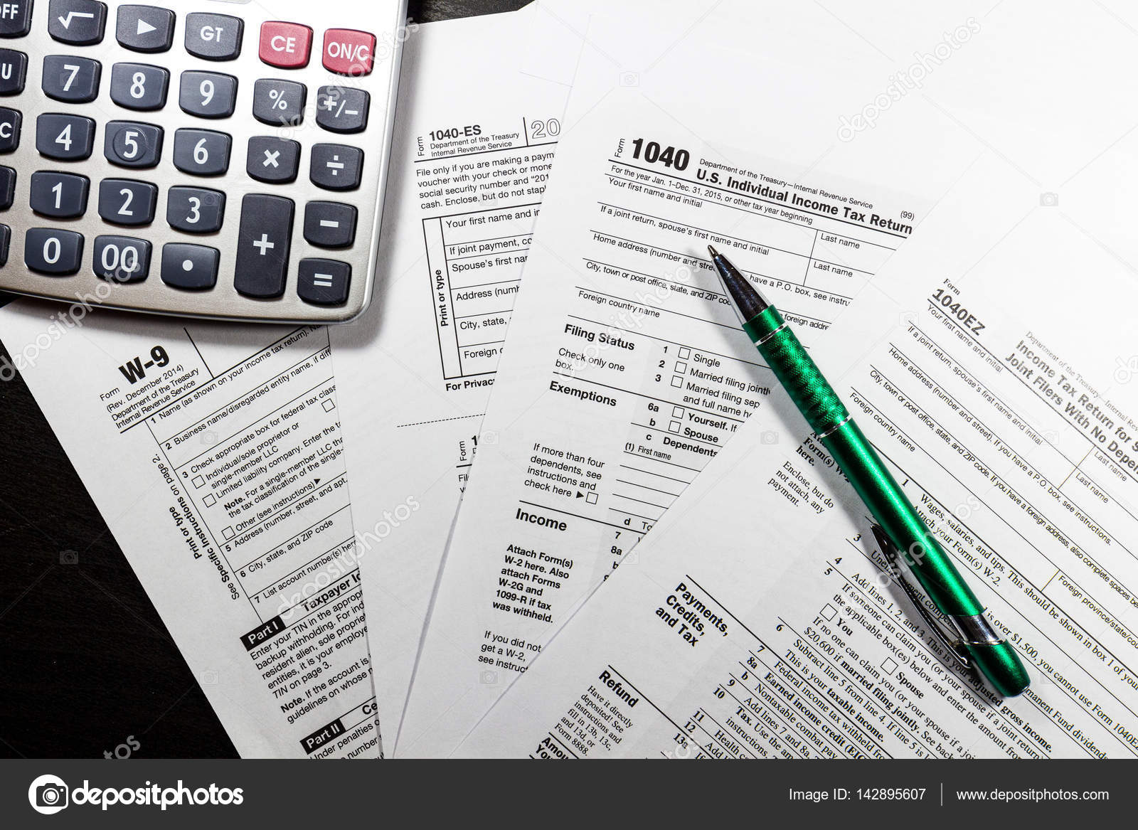 Us tax return form 1040 stock photo daliu 142895607 calculator and us individual income tax return blank papers form 1040 earnings and taxes concept photo by daliu falaconquin