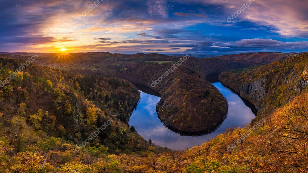 Panoramic view of river canyon with dark water and autumn colorf
