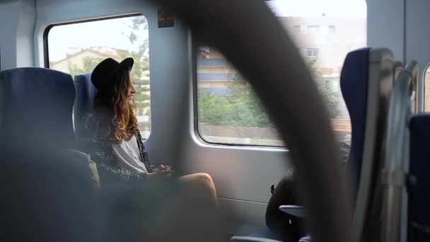 Girl rides around town in an electric train