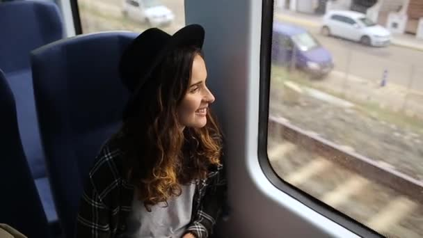 girl looks at a railroad in train