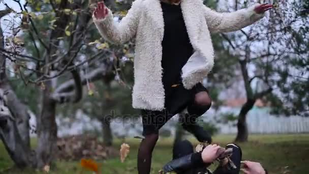 couple throwing leaves at each other