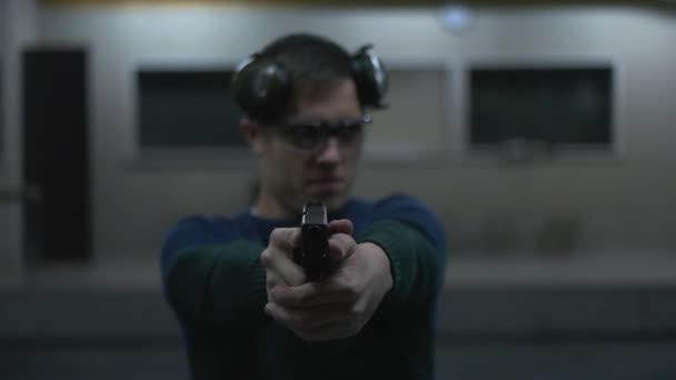 man holding a gun to the shooting range