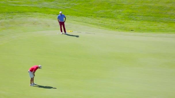 Men play golf top view