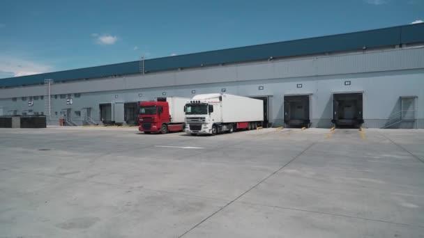 trucks depart from the logistics center