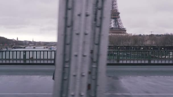 fashionable guy walking on a eiffel tower background