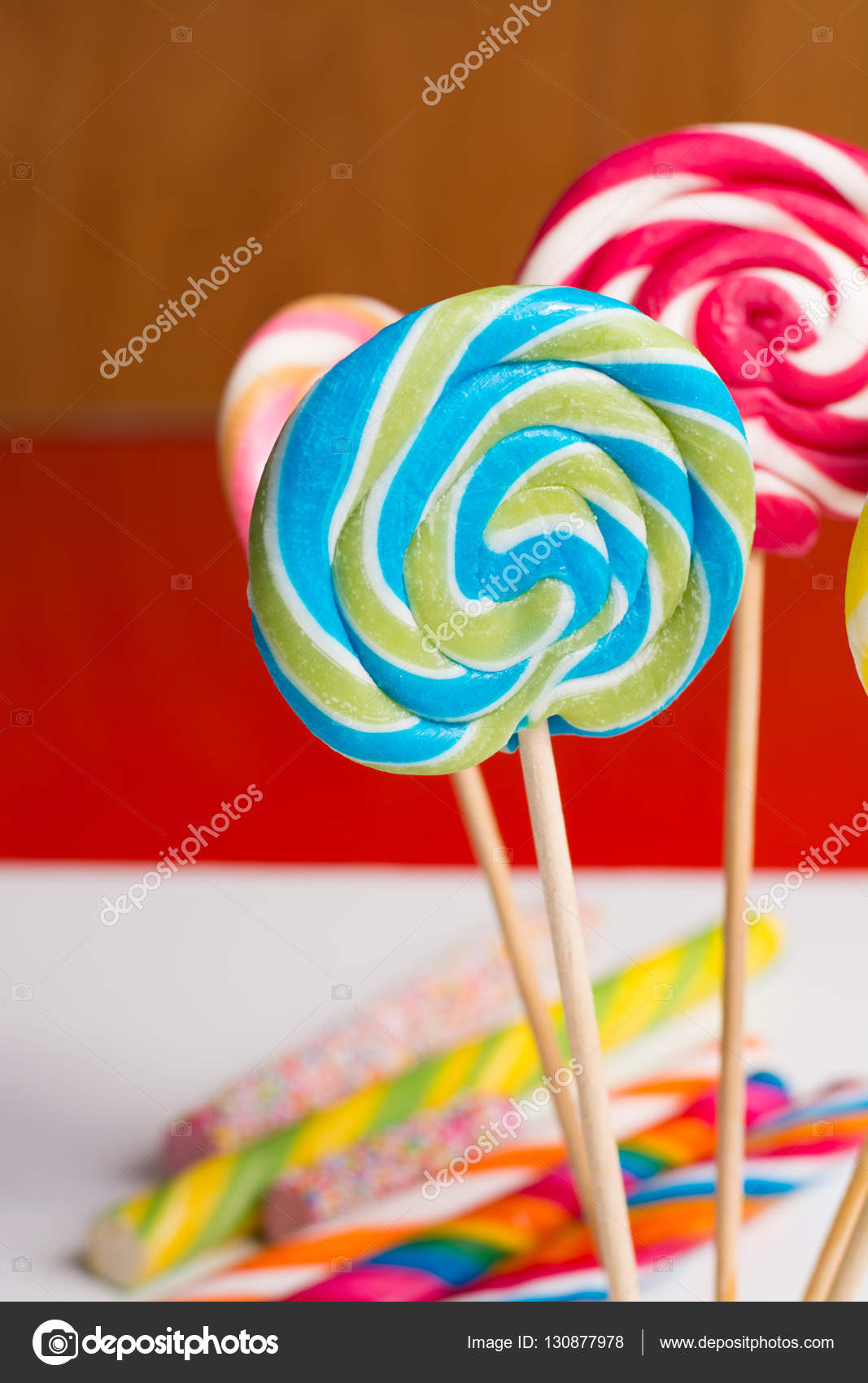 Multicolored sweet candy canes and twirls on wooden sticks — Stock ...