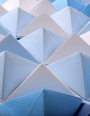Abstract blue tone paper poly made from tetrahedron background. Usefull for business cards and web.