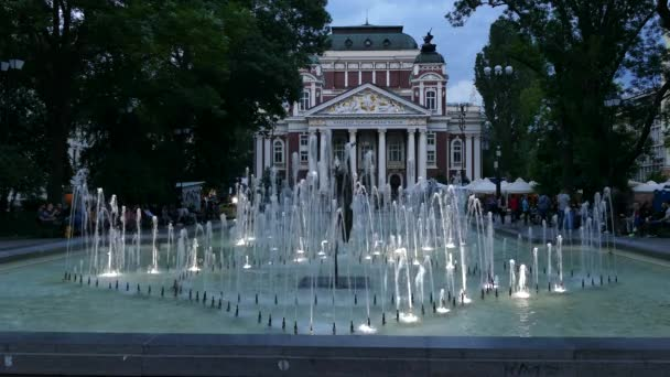 Ivan Vazov National Theatre and fountains in the city center of Sofia, Bulgaria at dusk. Sofia is the capital and largest city of Bulgaria
