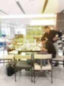 blurred image of teamwork people concept.Young team of coworkers making great business discussion in modern coworking office and talking with partners while showing new startup idea monitor