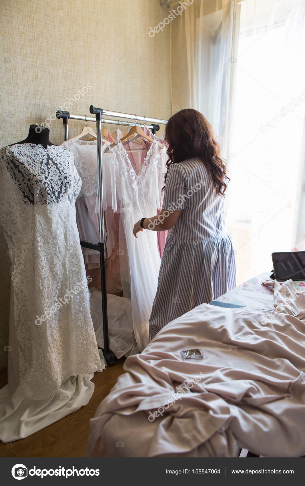 Dress designer making lace wedding dresses. — Stock Photo ...