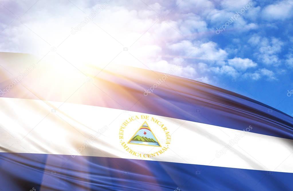flag of Nicaragua against the blue sky with sun rays