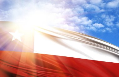 flag of Chile against the blue sky with sun rays