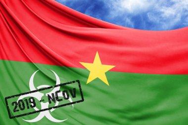 Novel coronavirus disease named 2019-nCoV with Burkina Faso flag closeup on blue sky background