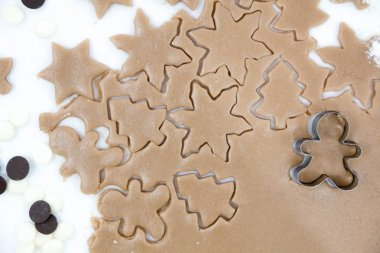 Christmas cookies. Baking . Roll out the dough to cut stars on a wooden background