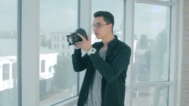 Realtor taking pictures of a real eatate and a window view.