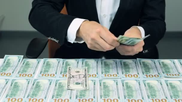 Many hundred us dollars. Successful man with lot of money.