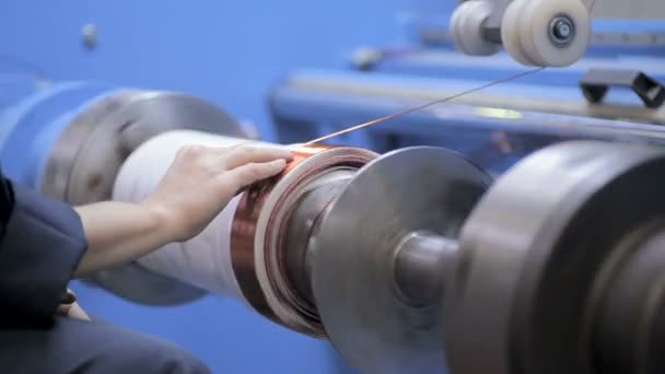 Copper wire wound, wrap copper coil, making electrical coil of a transformer. High-voltage transformer production.