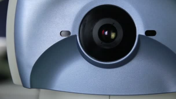 Modern automated medical machine examining eyeball  Eye examination test on  a professional medical equipment screen
