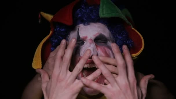 Hands take evil scary clown into the hell.