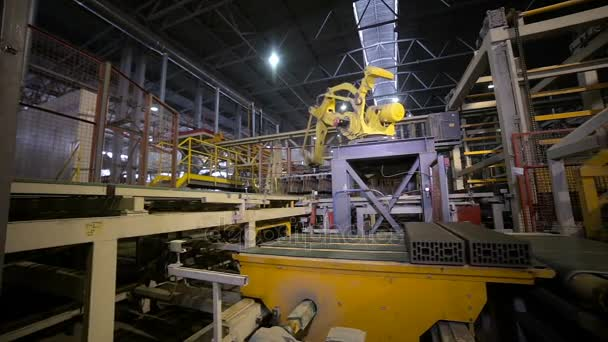 Automated machinery equipment. Robotic arm assembling products, bricks.