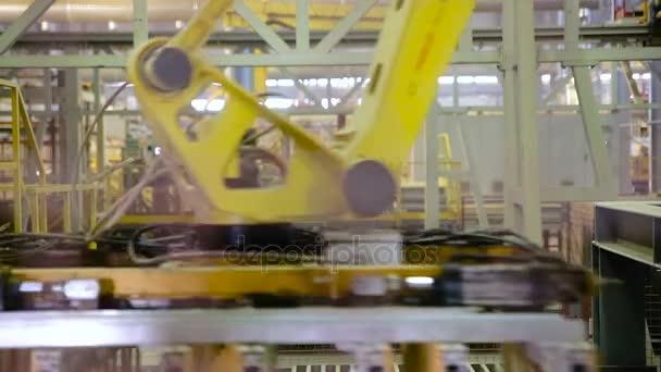 Moderní vybavení závodu. Roboti v průmyslové výrobě