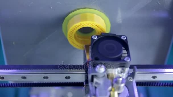 Three dimensional 3d printer printing plastic elements. Modern 3D printing technology. Close-up shot.