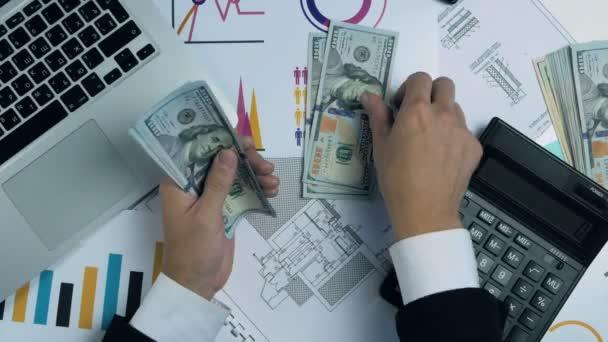 Businessman hands counting hundred dollar bills.