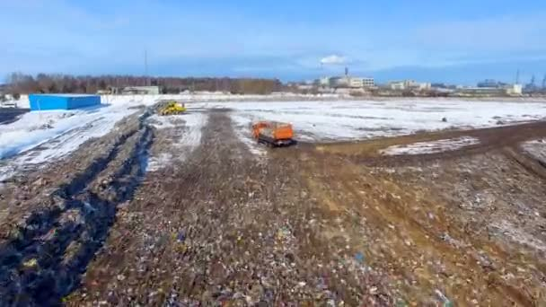 Aerial. Truck at a garbage dump, landfill. Waste site from above.