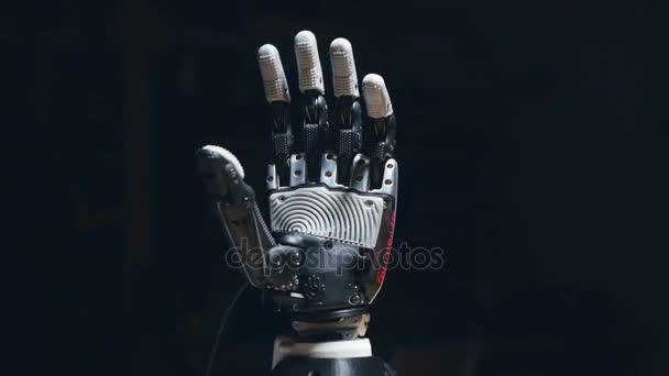 4K. Futuristic bionic arm made on 3D printer.
