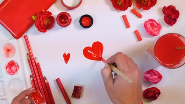 4K. Many hearts drawn on a paper. Red palette. Valentines or Mothers Day concept.