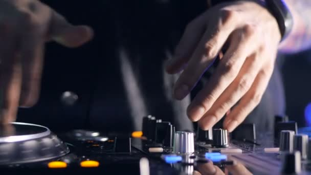 DJ Spinning, Mixing, and Scratching in a Night Club party. Nightlife, Music club life concept.