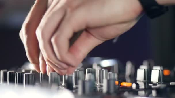 DJ hands plays at the disco. Nightlife concept.