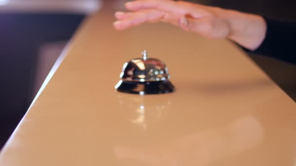 Woman call on a old hotel bell on a wood stand and get chip key from hotel room. 4K.