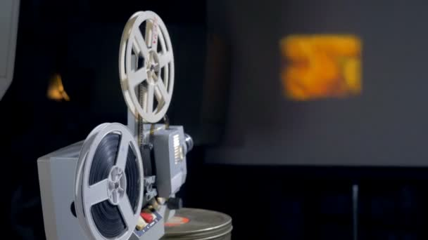 Mechanical movie projector in operation