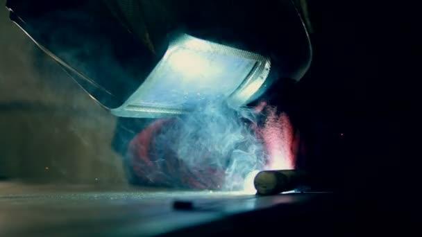 Man working with welding machine.