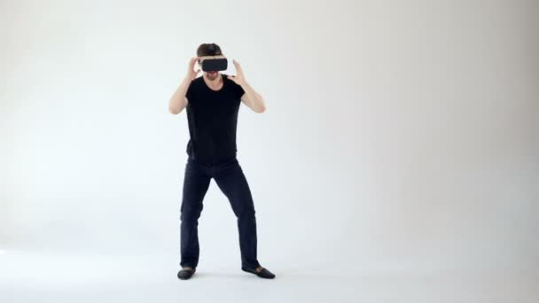 8e2dadcee0a4 Virtual reality concept. Man in VR headset boxing. — Stock Video ...