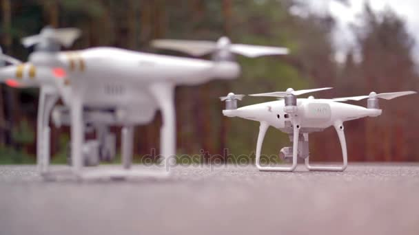 A close up of a modern quadrocopter taking off. Slow motion.