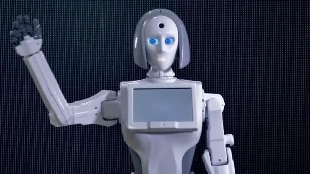 Bílé plastové robot mává svou ruku na pozdrav.