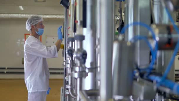 A food factory worker monitors the production