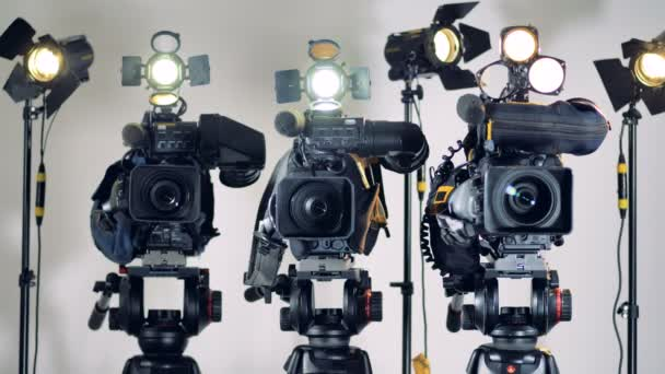 Several video cameras with  lighting turned off and on.