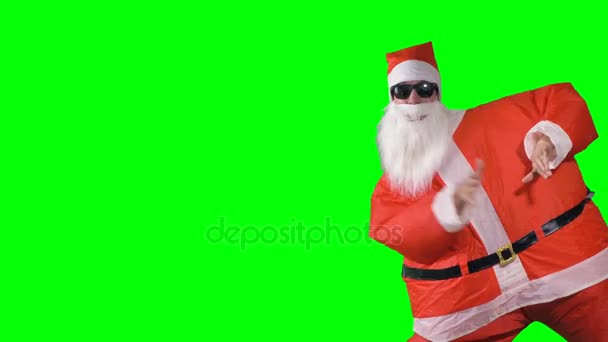 Santa claus enters the shot and makes greeting gestures stock santa m4hsunfo Images