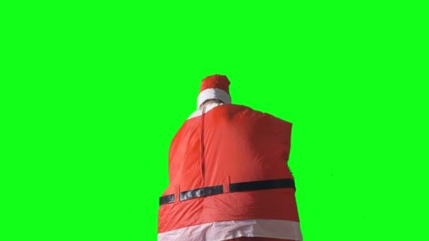 Santa Claus se otáčí a ukazuje notebook černá