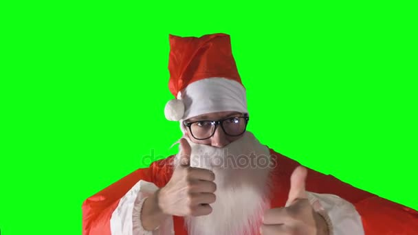 A close-up on Santa Claus giving thumbs up to the viewer.