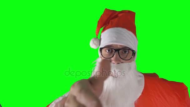 Detail na Santa Claus směřující ke kameře a vábí