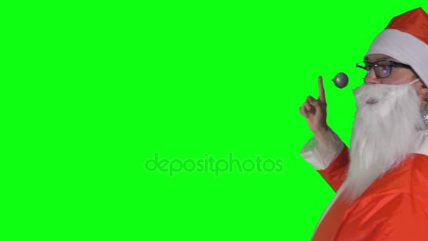 Santa Claus Vánoční cetka na jeden prst zdvihá, přenáší a ztrácí
