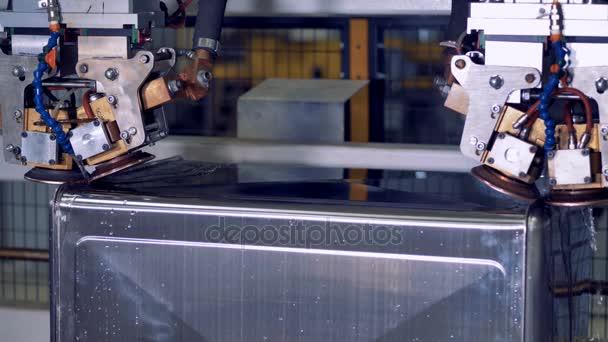 A gyár termelési vonal ipari robotikus eszközök.