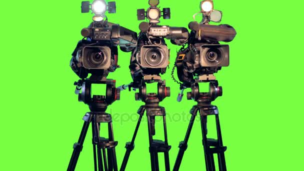 Professional broadcast studio video cameras on green screen.