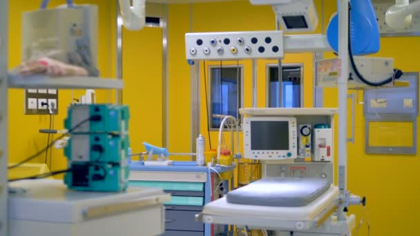 An operating room for babies with a small table and working surgery lights. 4K.